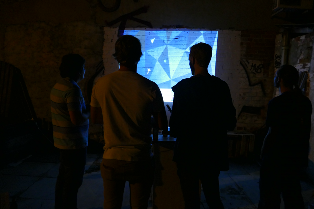People playing Arbalest projected on a wall